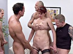 Redhead mature slut gets banged in hardcore gangbang action