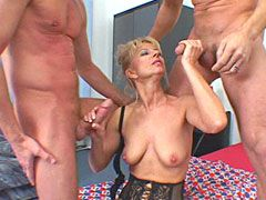 Blonde mature in black stockings sucking two hard cocks and hardcore fucked