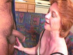 Redhead granny gives blowjob and gets hard dick in shaved..