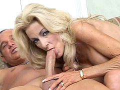 Blonde mature chick with huge boobs jumping on hard cock..