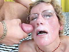Hot mature babe in glasses sucks tree cocks and gets hard..