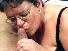 Granny babe in glasses gives blowjob and gets hard cock in hairy pussy