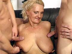 Busty granny gets two big cocks