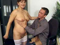 Aged mom in white stockings fucked by boy in office
