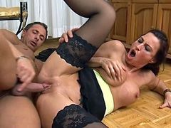 Sexy mom in black stockings gets cock in shaved pussy