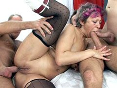 Horny granny in black stockings gets banged in gangbang