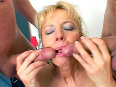 Blonde mature sucking two cocks