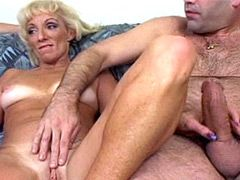 Blonde mature whore jerking and sucking two cocks and..