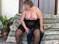 Fatty mature in stockings presses under itself thin man