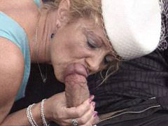 Aged lady in black stockings suck cock and gets cum on..