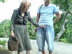 Redhead aged mom gets young cock in shaved pussy in forest