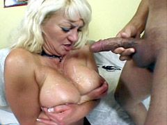 Blonde granny in black stockings gets big dick and tity cum