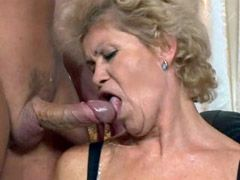 Granny in glasses with hairy beaver jumping on big cock