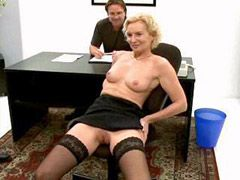 Sexy mature in black stockings getting..