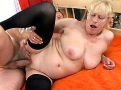 Blonde aged mom in black stockings doggystyle fucked on bed