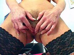 Blonde mature babe in black stockings gets gaint dildo in her pussy
