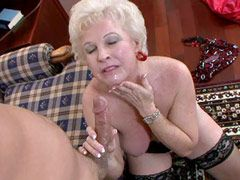 Hot granny in black stockings gets big cock in shaved pussy