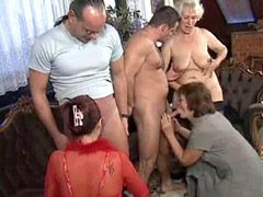 Mature whores fucking in orgy by many guys