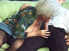Old grandmother with big boobs and hairy twat rides on cock