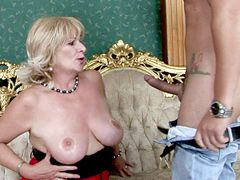 Busty mature lady with natural big breasts gets young cock