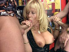 Busty blonde mature sucking two hard cocks and hardcore..