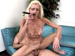 Blonde mature whore with cigar fucked doggystyle on bed
