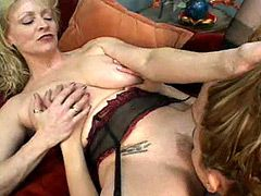 Mature lesbian and young chick pussy licking on bed