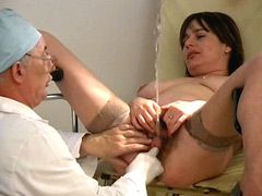Mature whore spreading legs in front of doctors and pissing