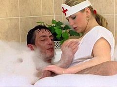 Busty mature nurse giving blowjob to guy in bath tub and fucking