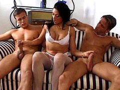 Mature bitch jerking two cocks and hardcore fucked in group sex