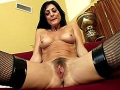 Older brunette whore exposes hairy..