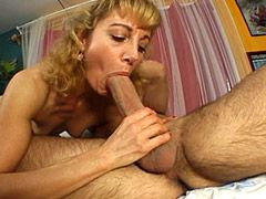 Blonde mature bitch gets strong cock in condom in her ass