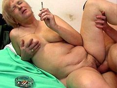 Mature whore smoking and sucking hard..