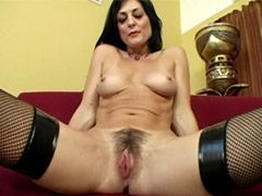 Brunette mature chick exposing hairy..