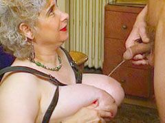 Granny with gigantic tits sucking cock and gets fucked on bed