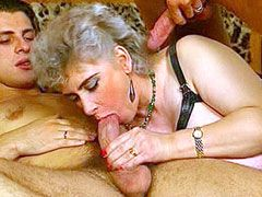 Granny with gigantic tits sucking cock and gets fucked on..