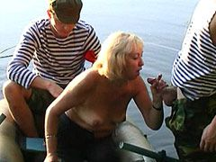 Blonde granny gets fucked in wild groupsex in boat