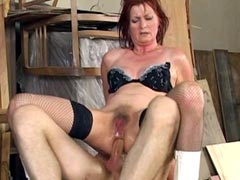 Brunette mature whore spreads legs to..