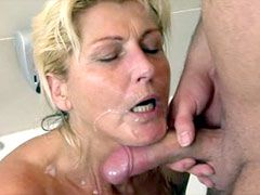 Blonde mature babe sucking and riding cock in toilet