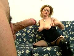 Mature whore in black stockings riding massive white cock