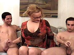 Busty mature lady jerking cocks and fucking in wild group orgy
