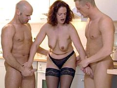 Sexy mature chick in black stockings having wild groupsex