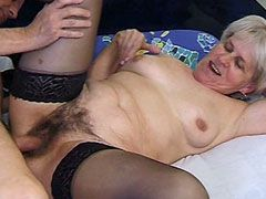 Granny in black stockings gets hard bang in hairy pussy