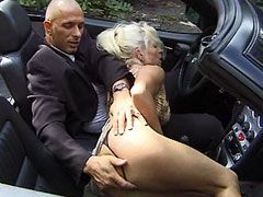 Sexy granny gives blowjob in car and gets hard bang
