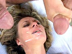 Mature slut jerking two huge cocks and fucking on bed for facial cumshot