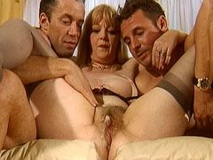 Mature chick gets double penetrated..