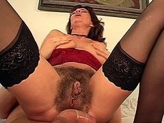 Hairy mature beaver gets hard snake in condom