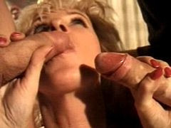 Granny whore gives blowjob to hard cocks and gets dped