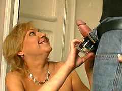 Mature gal jerking big cock and banged in hairy bush