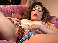 Mature gal getting deep insertion in her hairy cunt